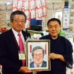 相撲絵師の松林モトキが奥田副知事を描くの写真
